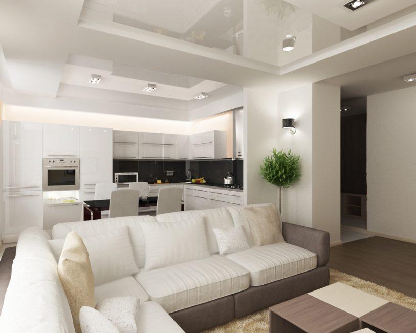 Светлая просторная кухня-гостиная с черным цветом стен под навесными шкафчиками
