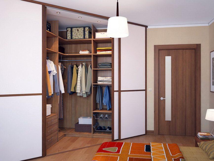 Угловой тип можно разместить как в спальне, так в гостиной – главное, правильно скрыть зону хранения одежды