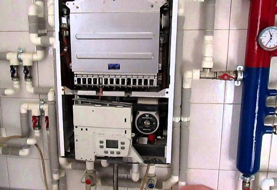 Внутренняя часть оборудования. Котел имеет несколько режимов защиты, которые в инструкции обозначены специальными символами