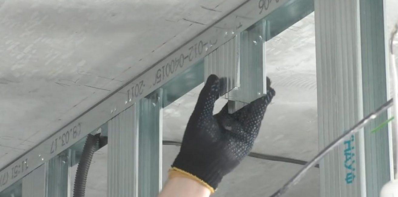 В каждом проёме, для крепления профиля для натяжного потолка